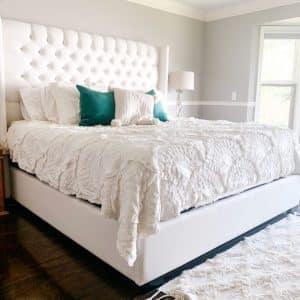 canadian made deep tufted panama bed with tall fabric headboard