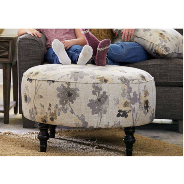 best home furnishings renae round ottoman shown in front of sofa