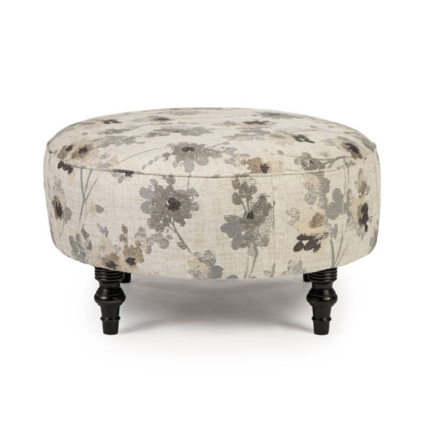 round renae ottoman in modern floral fabric with turned legs