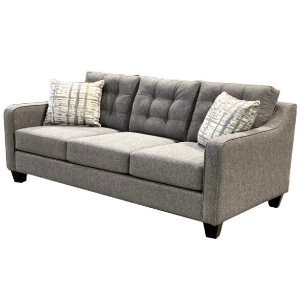 custom built caddy sofa woth modern tufting in back and narrow sloping arm