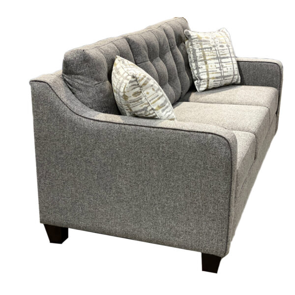 canadian made caddy sofa with tufted back and sloped arms shown from side
